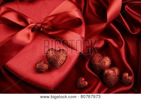 A group of red hearts on satin background