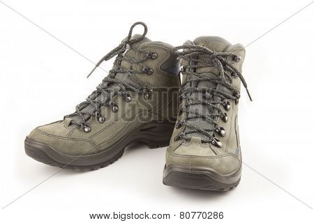 Couple of trekking new shoes isolated on white