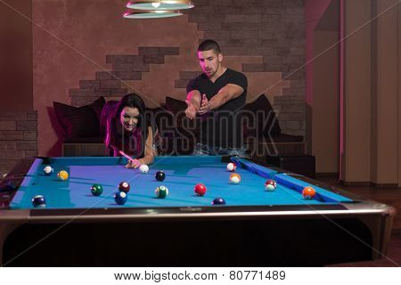 Man Showing His Girlfriend Where To Hit The Ball