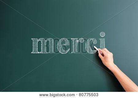 merci written on blackboard