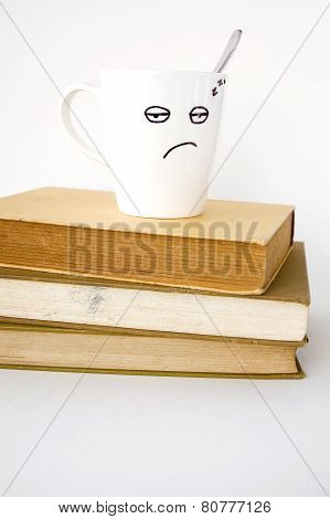 Sleepy Face Cup On Stack Of Book