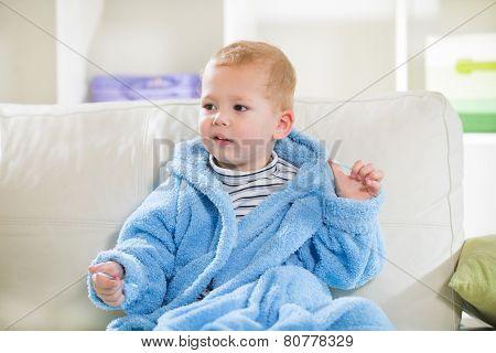 Boy holding a cotton swab