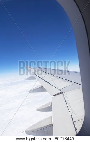 Airplane Window Looking Out Over The Wing