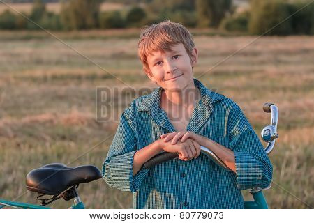 Portrait of smiling teenager boy with bike