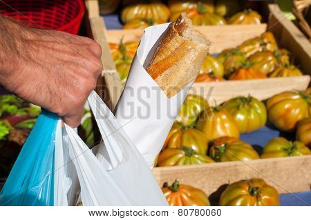 Man Buying Food On Local Market
