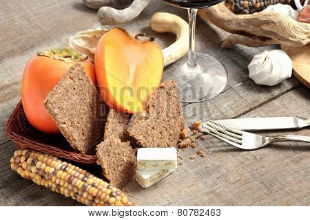 Winter Gourmet Composition With Persimmon, Cereal  Bread And Nougat
