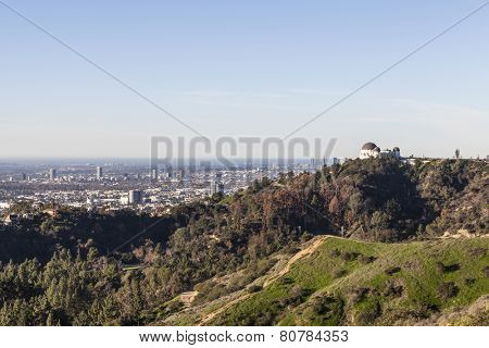 LOS ANGELES, CALIFORNIA, USA - January 14, 2015:  The famous Griffith Park Observatory with Hollywood and the pacific ocean in background.