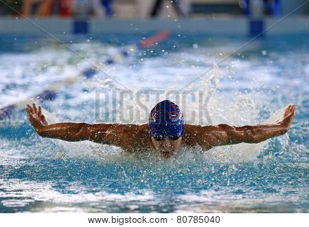 A Man Athlete Is Swimming In The Pool