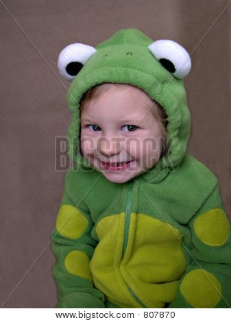 Child in frog costume