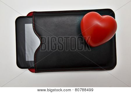 Tablet In Leather Case And Red Heart
