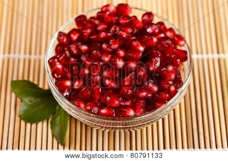 Grenadine Seeds With Little Green Leaf