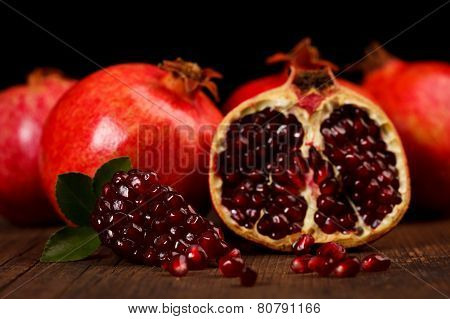 Grenadine Fruits And Seeds On Wooden Table