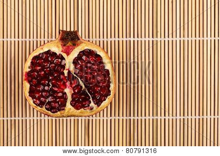 Half Pomegranate On Wooden Sticks
