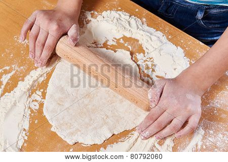 Girl Prepare Dough With Rolling Pin On Kitchen Table