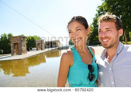 Madrid tourist couple by Temple of Debod. Tourists sightseeing in Madrid visiting tourist destinations and attractions in Madrid, Spain. Asian woman, Caucasian man.