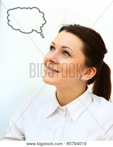 Thinking woman with idea in empty bubble looking up