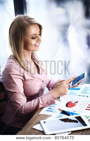 Business woman works with modern devices in office