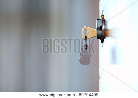 key in the door of the motel room