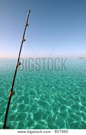 fishing rod over blue lagoon