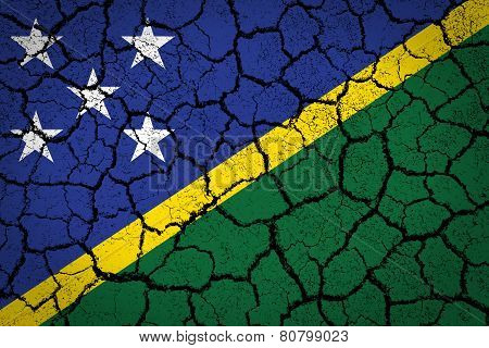 flag of Solomon Islands painted on cracked ground