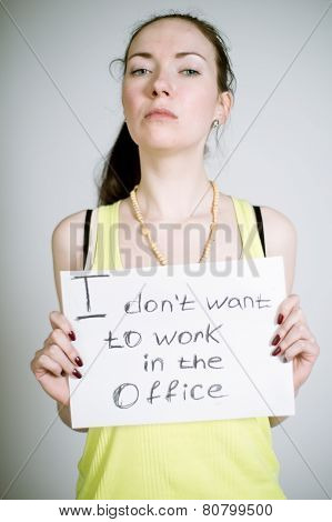 Artistic portrait of a real young woman with the sign in her hands