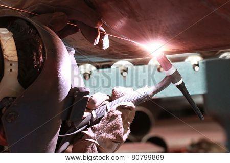 welder is welding big pipe
