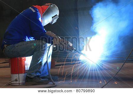 welder is welding steel part