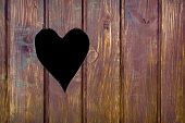 pic of wooden shack  - Wooden board with cut out heart shape - JPG