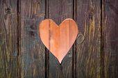 foto of wooden shack  - Wooden board with cut out heart shape - JPG