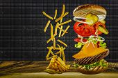 picture of fried onion  - Delicious french fries and cheeseburger stacked high with a juicy beef patty - JPG