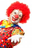 stock photo of comedy  - Portrait of a smiling clown isolated on white - JPG