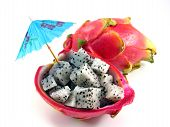 stock photo of dragon fruit  - Diced dragon fruit pieces in the shell next to a whole fruit - JPG