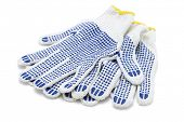 pic of stud  - White Cotton Gloves With Blue Rubber Studs On White Background - JPG
