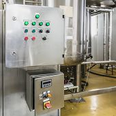 foto of pharmaceuticals  - Water conditioning or distillation room and control panel equipment on pharmaceutical industry or chemical plant - JPG