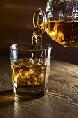 pic of whiskey  - whiskey and natural ice on old wooden table - JPG