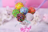 picture of cake pop  - Sweet cake pops in vase on table on pink background - JPG