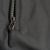 stock photo of zipper  - Black Polyester Twill Fabric Texture Background - JPG