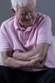 picture of elbows  - Senior man having painful elbow after injury - JPG
