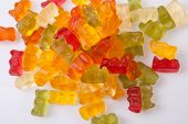 image of gummy bear  - Pile of colorful gummy bears isolated over white background - JPG