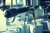 foto of morning  - Preparation of two espresso in coffee machines - JPG