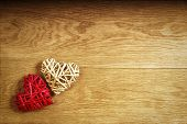 picture of two hearts  - Two beautiful romantic vintage hearts on a wooden oak background - JPG
