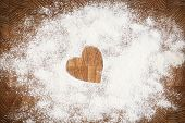 stock photo of home is where your heart is  - Heart of white flour on a wooden board - JPG