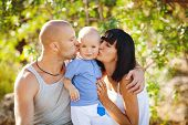 stock photo of cross-dress  - Happy young family - JPG
