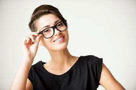 pic of shot glasses  - Beautiful young short hair woman adjusting her glasses and smiling - JPG
