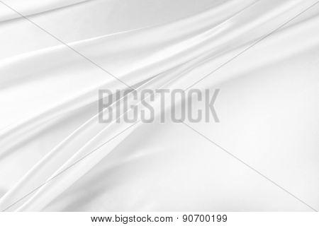 Closeup of rippled white satin silk fabric