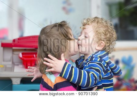 Little Boy Kiss A Little Girl