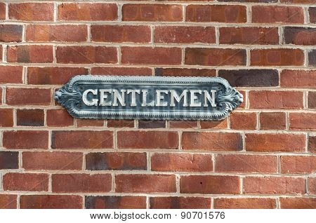 Antique Gentlemen Sign On Red Brock