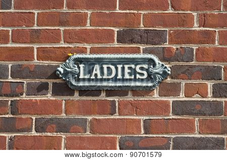 Vintage Ladies Sign On Brick Wall
