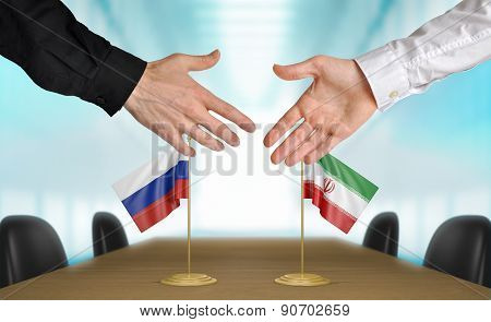 Russia and Iran diplomats agreeing on a deal