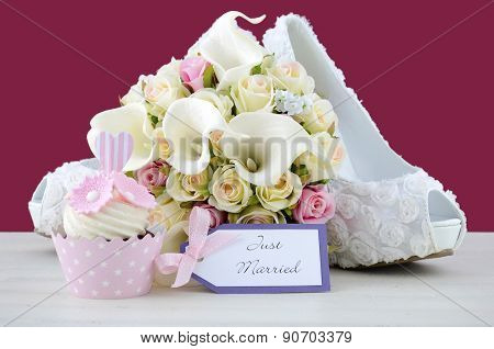 Wedding Concept Cupcakes And Shoe On Marsala Background.